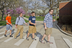 (l-r) Caleb, Jacob, Joshua, and Ben Copeland mimic the Beatles' Abbey Road album cover shot as they make their way across campus.