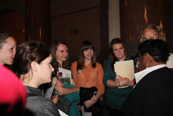 Sociology students speak with Illinois Representative Monique Davis during Advocacy Day at the capitol building in Springfield.