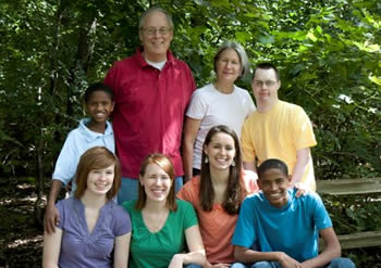 The Timmermans family gathers for their first family photo since the boys' arrival from Ethiopia in September. Seated in the front row (l to r): Jess, Katie, Becca, and Getenet; back row (l to r): Fekadu, Steve, Barbara, and Paul