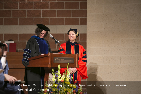 Professor White (right) accepts a well-deserved Professor of the Year Award at Commencement