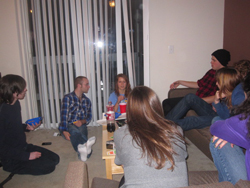 Playing Taboo after making dinner with friends at our apartment.