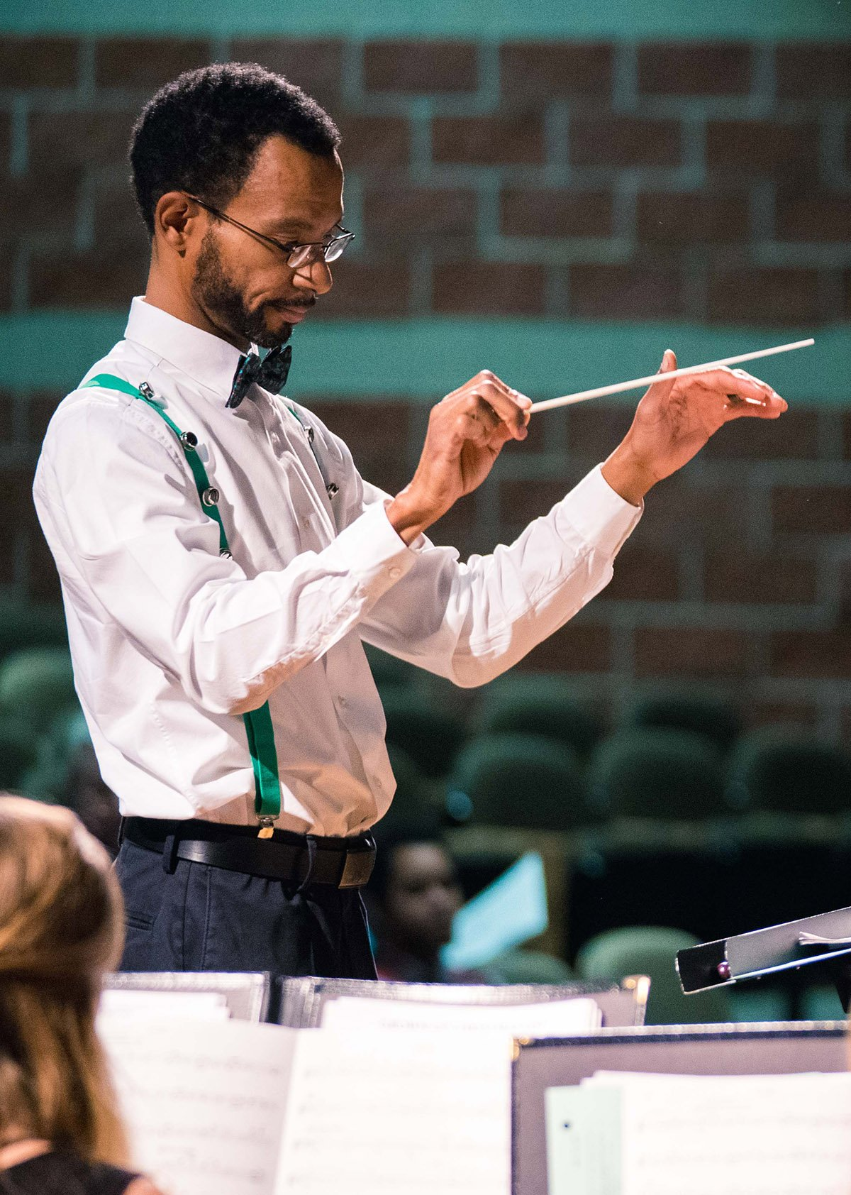Conductor conducting the chamber music recital