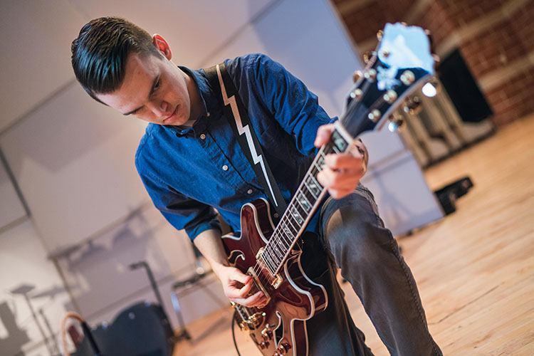 Matt Meyrick playing guitar