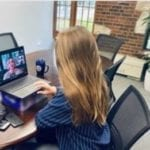 Student watching TrinTalk on computer