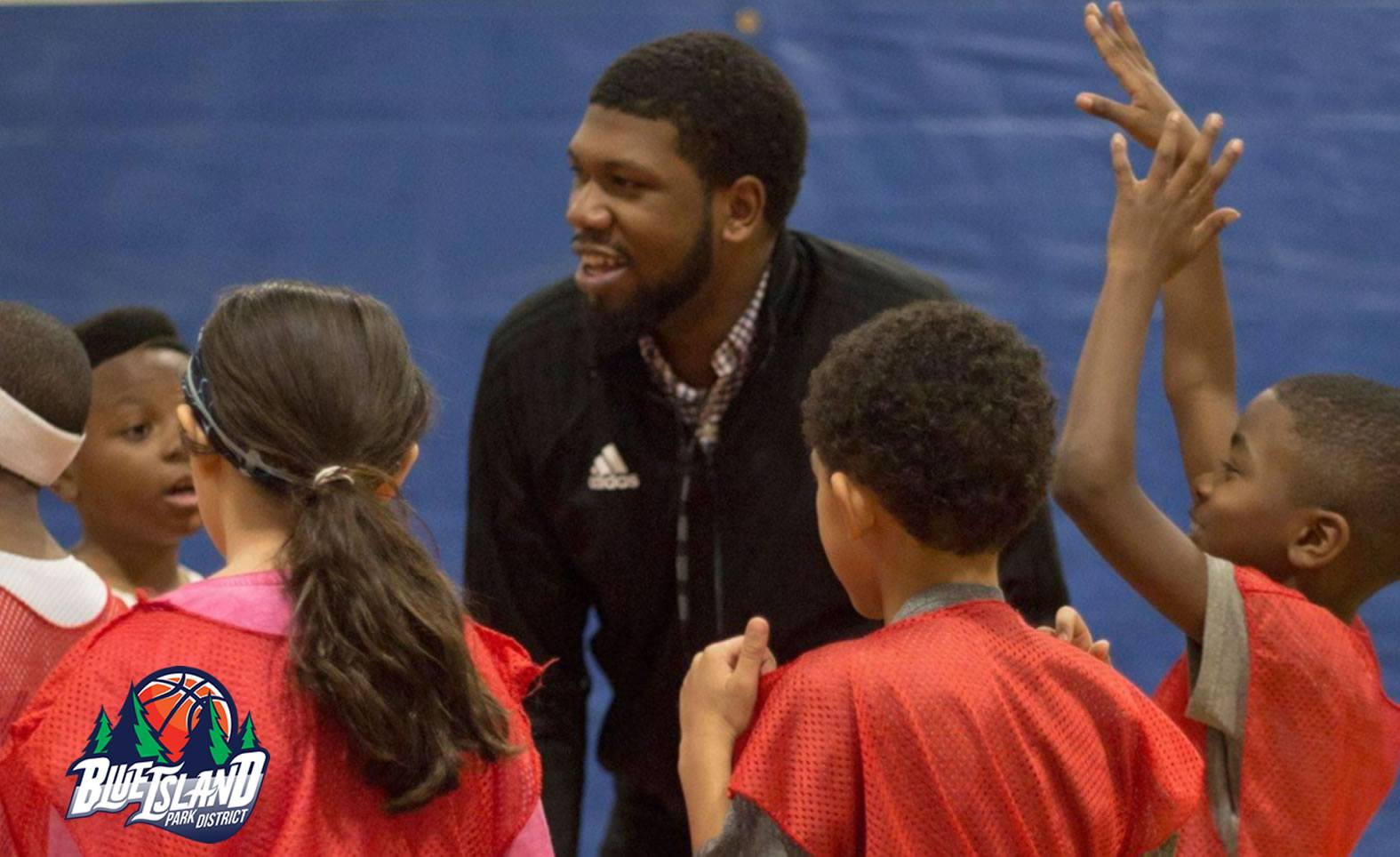 Joshua Edwards '15 coaching students at the Blue Island Park District. Photo by Blue Island Park District